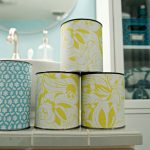 Ex cans covered with patterned paper as the beautiful additional storage for under bathroom sink organizer