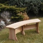 Flat wooden bench in curve shape