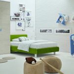Green Bed Furniture With White Bedding Blue Work Desk With White Chair Three Unique Floating Bookshelves In Blue And White Textured Wall System Clothes Closet Storage In Blue And Light Grey