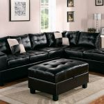 High class black leather coated sectional sofa with black leather ottoman smooth and soft grey area rug gloss stain wooden floors