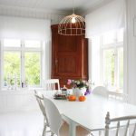 Higher corner wooden hutch idea for a dining room a set of dining furniture in white theme a decorative pendant lamp