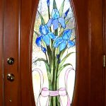 Interior wood door with oval stained glass panel in the center
