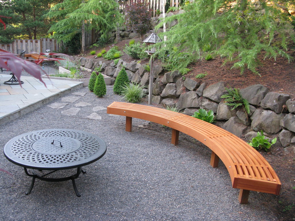 Larger Curved Bench Made Of Wooden For Patio A Round Patio Table With  Firepit In The