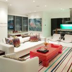 Laura U Interior Design Houston Texas for modern colorful living space with modern furniture and contrast table statement strip colorful carpet