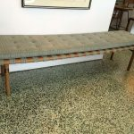 Long upholstered bench design with wood base and legs