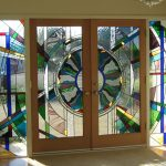 Luxurious interior door  with multiple color stain glass panels and stained sidelights
