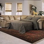 Luxurious leather sectional sofa with sleeper classic area rug rustic side table natural fiber window shades