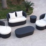 Modern black stained wood patio furniture with white cushions and pillows black stained wood side table in round shape a black stained wood table