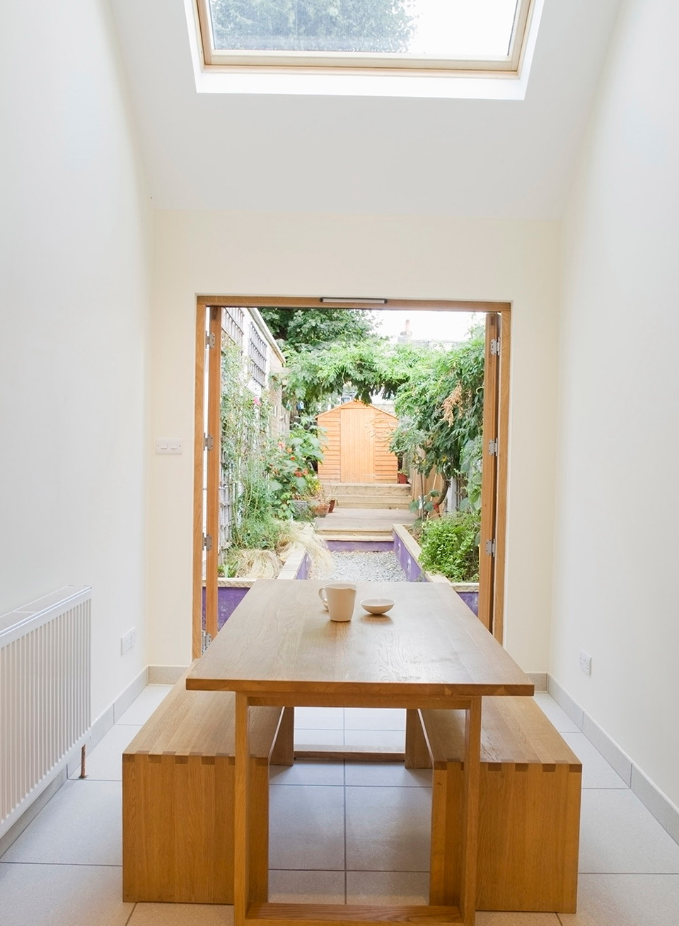 dining table in narrow size two wood benches as the dining chairs