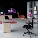 Office decoration idea with wood desk with cabinet underneath black office chair a corner document shelving unit a wood credenza furniture a purple decorative lamp