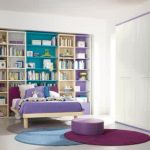 Pale stained wood bed furniture built in shelves round chair in purple white closet storage purple open shelves small work desk with purple chair three round bedroom rugs in purple blue and grey