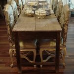 Pallet Wood Narrow Table With Eight Luxurious Chairs For Dining Room A Group Of Classic Dishware