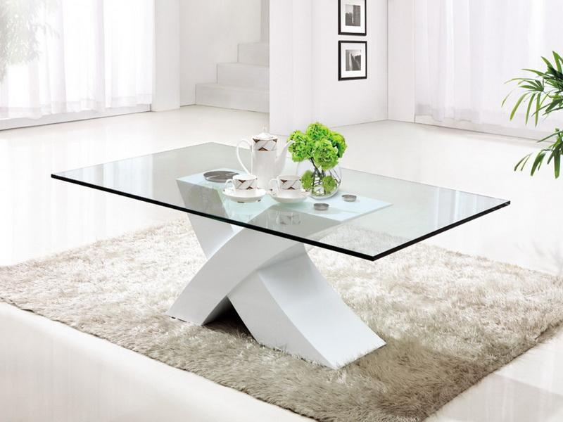 Rectangular glass coffee table with unique base grey shag rug for living room