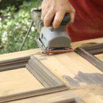 Refinish front door orbital sanding wooden front door repairing weather damage front door