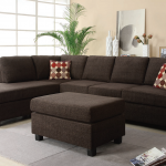 Reversible sectional chair with chaise in brown an ottoman furniture in brown thicker light grey area rug multicolor polka dots throw pillows