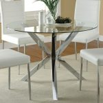 Round glass top table with steel legs white chairs tiny white rug