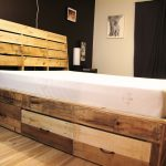 Rustic wood bed frame idea with rustic headboard and drawers system underneath white bed linen
