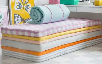 Several options of IKEA mattress toppers in multi color options