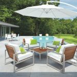 Simple classic Thomasville outdoor furniture white metal wooden chairs green cushions freestanding white umbrella cover natural color tile floor backyard small swimming pool