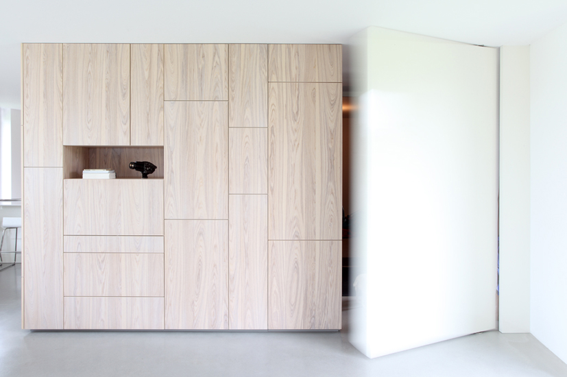 Simple minimalist built in cabinets with single shelf made of light wood & Built In Cabinet Ideas | HomesFeed
