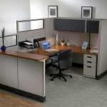 Simple office decorating idea U shape office desk with drawer system and upper cabinet and also higher panels an office chair with wheels grey area rug