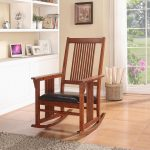 Simple wood rocking chair with black leather cushion in mission style modern wool area rug large shelving unit