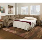 Sleeper sectional furniture in brown color modern area rug wood flooring idea block butcher side table with artistic table lamp