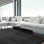 Slim sectional in white white throw pillows flower patterned throw pillows grey wool area rug wood floor idea