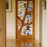 Stained glass interior door idea with floral and animal pattern