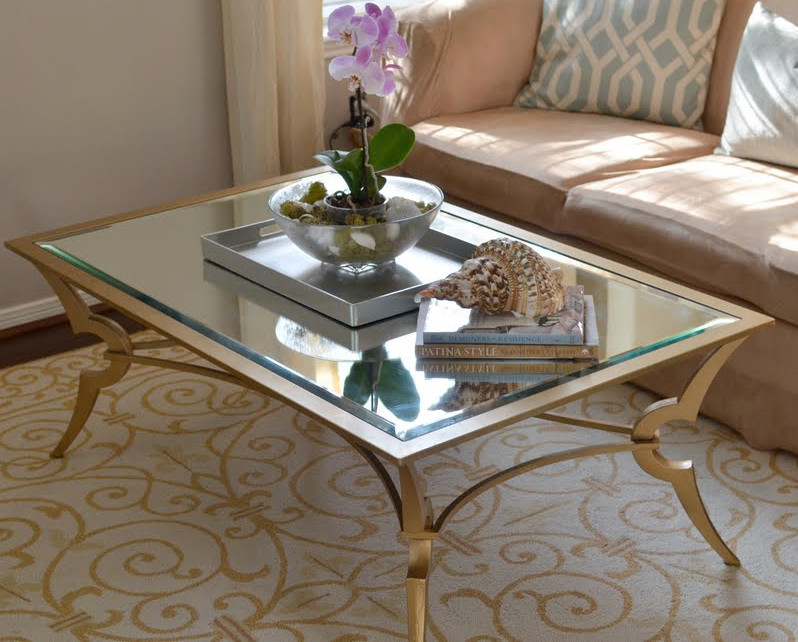 Stunning Glass Top Table With Gold Toned Iron Frame And Legs Light Brown  Sofa With Decorative