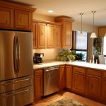 Sweetlake Interior Design LLC interior decorator Houston Texas for modern sleek look kitchen with natural wooden cabinets white granite counter top and wooden floor
