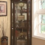 Three side corner hutch with glass door feature and darker stain