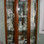 Three side glass door hutch storage system with dark stained wood frame
