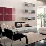 Two black chairs and  a white ottoman in modern style white wool area rug idea wall bookshelves in white color floating modern cabinets in maroon color