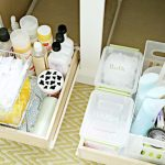 Well organized items in under bathroom sink storage