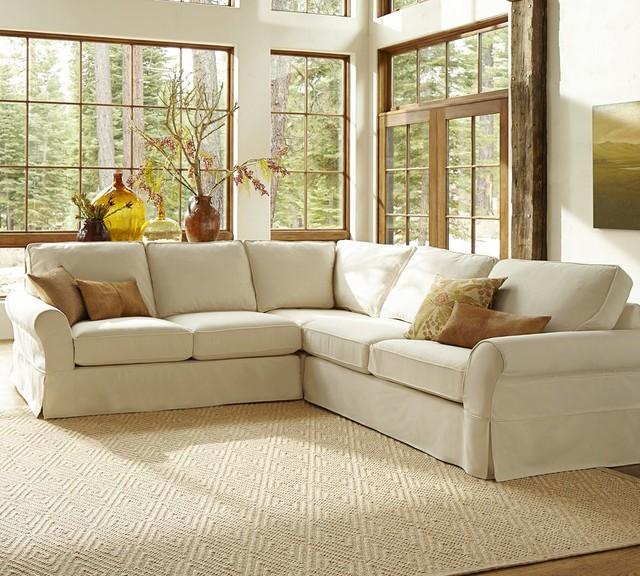 White L shape with brown throw pillows textured white area rug glass windows with wood trims : traditional sectionals - Sectionals, Sofas & Couches