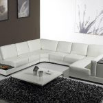 White U shape sectional sofa modern white coffee table with metal legs deep grey shag rug idea for living room