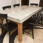 White granite narrow table for dining room black elegant dining chairs an area rug with modern black pattern