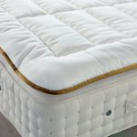 White mattress pad idea with gold tone decorative line