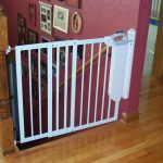 White metal safety gate for kids completed with high tech features