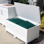 White wooden bench with storage feature