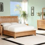 Wooden Bed Frame In Modern Style Wood Side Table With Drawer System Modern Table Lamp A Vanity With Storage System And Wood Framed Mirror White Bedroom Rug With Black Frame Some Unique Wall Arts