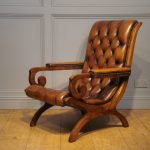 adorable and glamorous leather slipper chair with brown scheme and tufted back and seat plus wooden frame decorated with solid hardwood floor