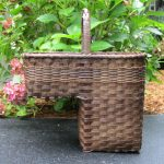 adorable bamboo basket design for stairs with middle handle on concrete patio aside garden