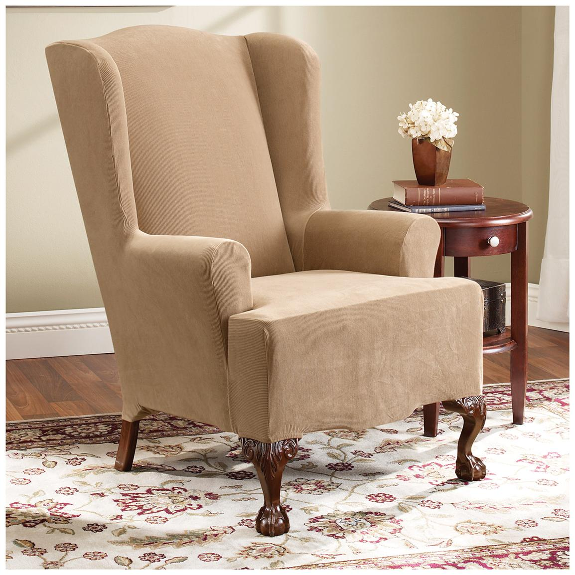Adorable Cream Wingback Slipcover Sofa Design With Dark Brown Wooden Legs  And Wooden Side Table On