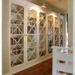 adorable designed white bookcase with glass door design with diamond shape surface decoration on wooden floor