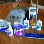 adorable home cleaning tools with gray steam cleaning and blue mop and some liquid for cleaning wooden floor