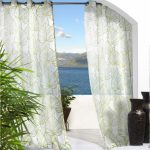 adorable indoor outdoor curtains in white with leaf pattern and adorned with ceramic and greenery