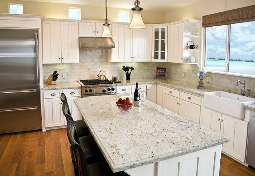 Add luxury to your kitchen with river white granite for Granite countertop design ideas