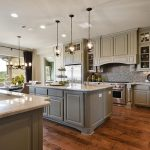 adorable kitchen ideas with wood vent hood and elegant wooden kitchen cabinet and cool backsplash plus marble countertop plus pendant lamp
